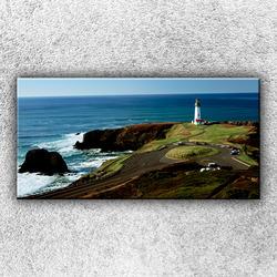 Foto na plátno Maják na útesu 100x50 cm